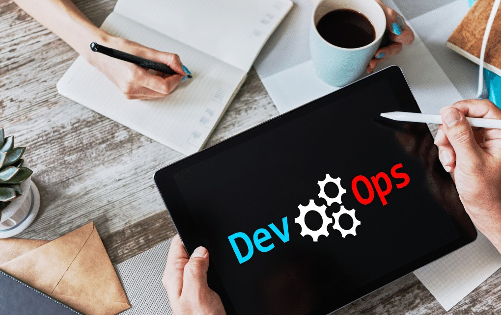 tablet with DevOps Logo in blue and red colour