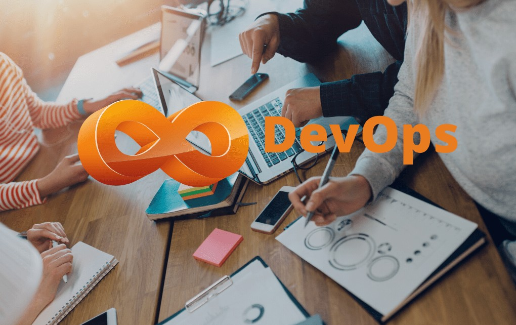 DevOps logo with notepad, pen, woman hand in the background
