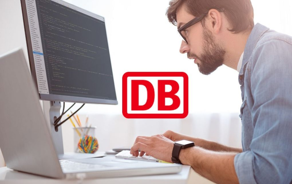 software developer working on computer and DB logo
