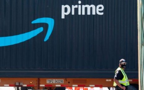 Amazon prime logo on dark blue wall