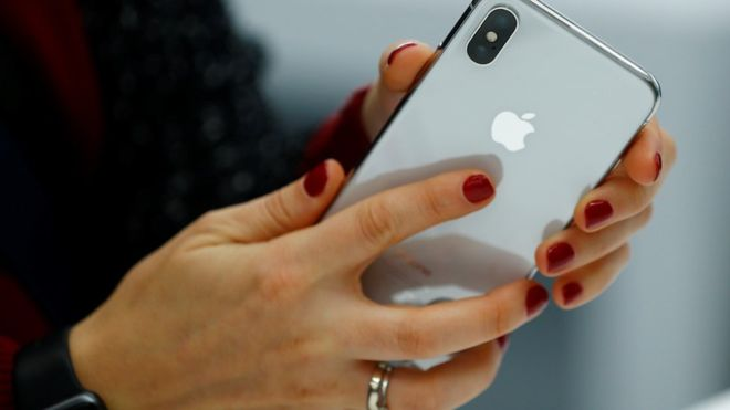 Apple Iphone in a woman's hand