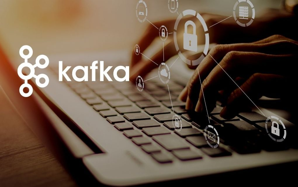 laptop computer with technology graphics and kafka logos